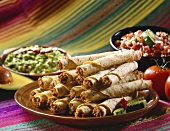 Plate of Taquitos with Guacamole and Salsa