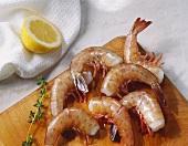 Unpeeled Shrimp on Cutting Board