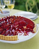 Plum Tart with a Slice Removed