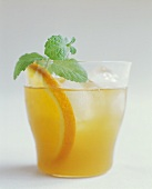 Orange Drink with Mint Garnish