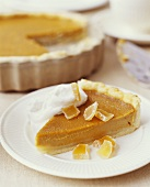 Slice of Pumpkin Pie with Candied Citrus and Cream