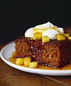 Piece of Cake with Pineapple Sauce and Whipped Cream
