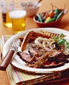 Sliced Steak with Spicy Pepper Sauce and Grilled Vegetables