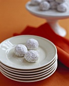Three Wedding Cookies on Stacked Plates