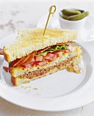 Half of a Layered BLT Sandwich on Toasted Bread
