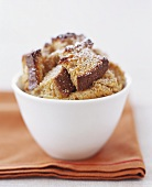 Small Bowl of Bread Pudding Dusted with Powdered Sugar