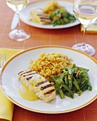 Grilled Fish with Beans and Rice on Dinner Table