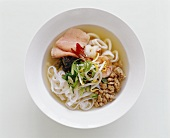 Asian soup with rice noodles and seafood