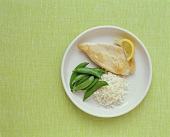 Plain Chicken Breast with White Rice and Snap Peas on a Plate