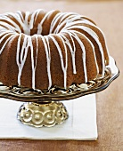 A Bundt Cake with Icing on a Pedestal
