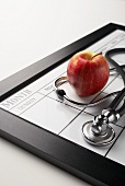 An Apple a Day Calendar with Stethoscope