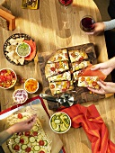 Pizza Party; People Making Pizza and Serving Cooked Pizza