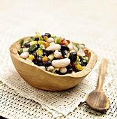 Bean Salad in a Wooden Bowl; Wooden Spoon