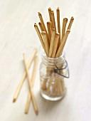 Thin Breadsticks in a Glass Jar