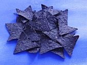 Blue Corn Chips on a Blue Background