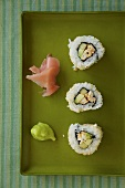 California Rolls on a Tray with Pickled Ginger and Wasabi