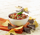 Bowl of Fresh Salsa with Blue and Yellow Corn Chips