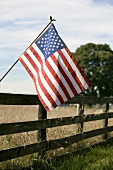 American Flag on Fence in the Country