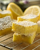 Lemon Squares Dusted with Powdered Sugar on a Rack