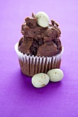 Chocolate Muffin Topped with Chocolate Frosting and Candy Egg