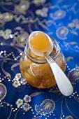 Piece of Stem Ginger on Spoon on Jar