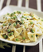 Cream Sauce with Sausage and Peas over Farfalle
