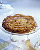 Whole Upside Down Apple Cake on Pedestal Dish