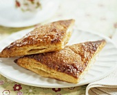 Two Apple Turnovers on White Plate