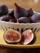 Halved Fig In Front of a Bowl of Figs