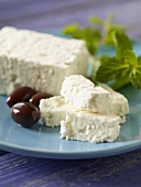 Feta Cheese and Olives on a Blue Plate