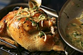 Spooning Onion Herb Sauce Over Roast Chicken