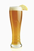 Tall Glass of Hefe Weiss Beer with Lemon Wedge