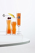 Three Fruity Cocktails in Tall Glasses