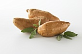 Three Sweet Potatoes on a White Background