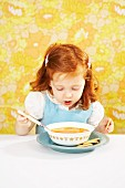 Red Headed Girl Eating Tomato Soup