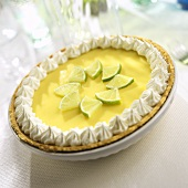 Key Lime Pie with Limes and Whipped Cream