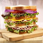 Club Sandwich with Ham, Turkey, Roast Beef, Cheddar and Swiss Cheese
