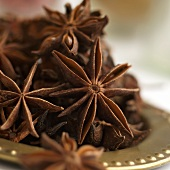 Star Anise on a Gold Plate; Close Up