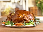 Stuffed Turkey on a Platter with Brussels Sprouts and Carrots