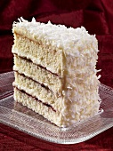 Slice of Coconut Raspberry Layer Cake