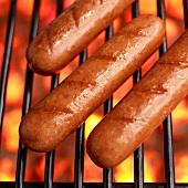 Three Hot Dogs on a Hot Grill