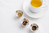 Three Bowls of Exotic Tea Leaves; Cup of Tea