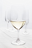 Glass of White Wine; Empty Wine Glasses