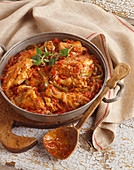 Chicken Cacciatore in Pan; Wooden Spoon