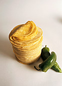 Stack of Corn Tortillas; Jalapeno Peppers