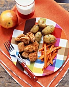Chicken Nuggets with Roasted Potatoes and Carrot Sticks