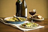 Slice of Vegetable Quiche on a Plate; With Red Wine