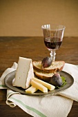 Plate with Cheese, Bread and Figs; Wine