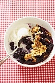 Bowl of Blueberry Cobbler with Vanilla Ice Cream