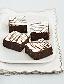 Four Frosted Mississippi Mud Brownies on a Plate